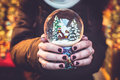 Woman holding snow globe on the christmas fair Royalty Free Stock Photos