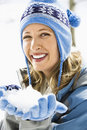Woman holding snowball. Royalty Free Stock Image