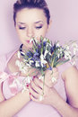Woman holding snowdrops tinted young beautiful a bouquet of Royalty Free Stock Image