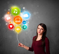 Woman holding social media balloon pretty young colorful icons Stock Photo