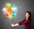 Woman holding social media balloon pretty young colorful icons Stock Photography