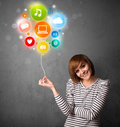 Woman holding social media balloon pretty young colorful icons Royalty Free Stock Images