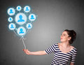 Woman holding social network balloon