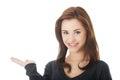 Woman holding something imaginary on hand smiling palm Stock Image