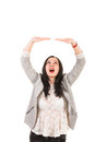 Woman holding something over head amazed copy space isolated on white background Stock Photos