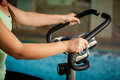 Woman holding steering heel on bike trainer Stock Images