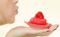Woman holding sweet strawberry cupcake Royalty Free Stock Photo