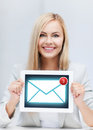 Woman holding tablet pc with email sign Royalty Free Stock Photos