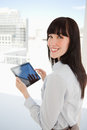 Woman holding a tablet pc in her hands Stock Photo