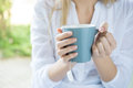 Woman holding tea mug closeup shot of a close up of young s hand a cup of hot relaxed girl drinking shallow Stock Photo