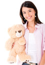 Woman holding a teddy bear casual and smiling isolated over white Royalty Free Stock Photo