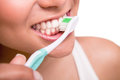 Woman holding a tooth brush Royalty Free Stock Photo