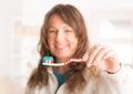 Woman holding toothbrush focus on brush Royalty Free Stock Photo