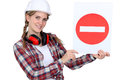 Woman holding a traffic sign Royalty Free Stock Photos