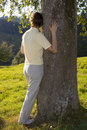 Woman holding a tree Royalty Free Stock Photo