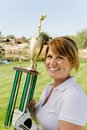 Woman Holding Trophy On Golf Course Stock Images