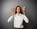 Woman holding two masks with different mood serious Royalty Free Stock Photo