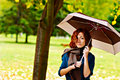 Woman is holding umbrella in the autumn forest Stock Images