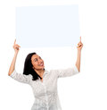 Woman holding up a blank white billboard advertise your business here pretty female whiteboard above her head Royalty Free Stock Photography