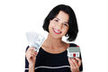Woman holding US dollars bills and house model Royalty Free Stock Photo