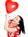 Woman holding valentine heart balloon over Stock Photo
