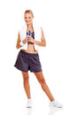 Woman holding water cheerful young bottle after workout on white background Stock Photography