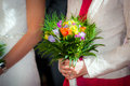 Woman holding a wedding bouquet at ceremony Royalty Free Stock Images
