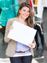 Woman holding a white banner Royalty Free Stock Images