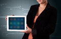 Woman holding a white tablet with blurry apps young Stock Photo