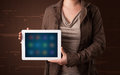 Woman holding a white tablet with blurry apps young Stock Photos