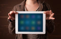 Woman holding a white tablet with blurry apps young Royalty Free Stock Image