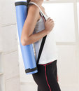 A  woman holding a yoga mat Royalty Free Stock Image