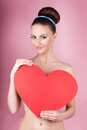 woman holds big red heart i love you in her hands
