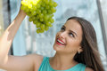 Woman holds a bunch of ripe grapes above her head. Royalty Free Stock Photo