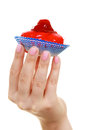 Woman holds cake strawberry cupcake in hand Royalty Free Stock Photo