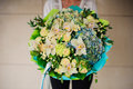 Woman holds a green bouquet Royalty Free Stock Photo