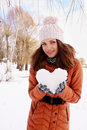 Woman holds a heart of ice in the hands Stock Photos
