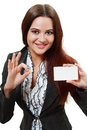 Woman holds out a business or credit card Stock Photo