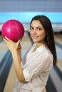 Woman holds pink ball in bowling club Royalty Free Stock Images