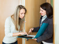 Woman holds a social survey on the doorstep Royalty Free Stock Images