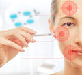 Woman holds a syringe near the face Royalty Free Stock Photo