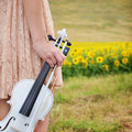 Woman holds vilolin alone young violin and bow in her hand Stock Images