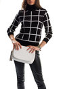 Woman holds white clutch bag. Royalty Free Stock Photo