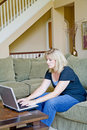 Woman at Home on Computer Royalty Free Stock Photos