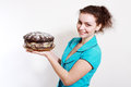 Woman with homemade pastry beautiful or torte or cake she made really herself Royalty Free Stock Images
