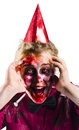 Woman with horror make up and party hat a in a a happy expression Royalty Free Stock Photography