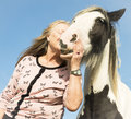 Woman and horse beautiful mature embracing her Stock Photography