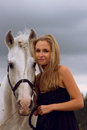 Woman and horse blond girl with white Stock Photo