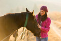Woman horse paddock beautiful touching in the Stock Photo