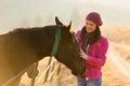 Woman horse paddock beautiful touching in the Stock Photo